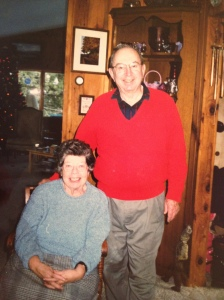 Grandma and Grandpa with a Christmas tree in the background