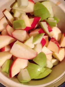 Roughly chop some apples.