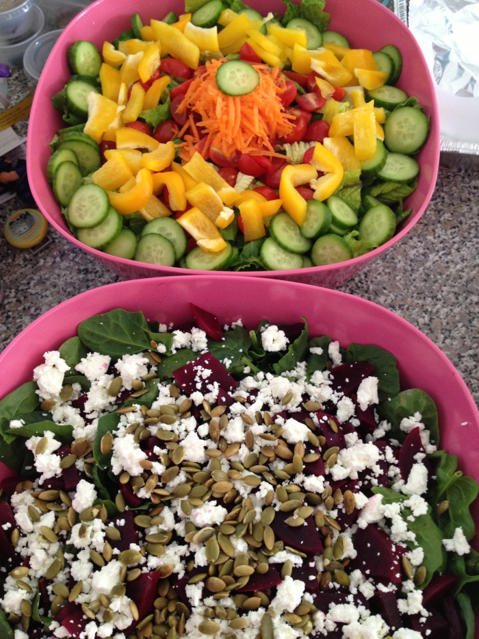 Rainbow green salad on top and spinach salad with beets and goat cheese on the bottom.