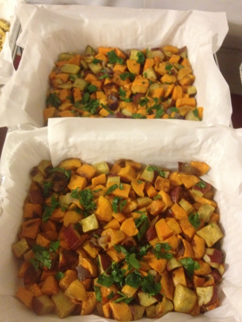 Roasted sweet potatoes and yams. I simply tossed chopped sweet potatoes (Which are actually white! Who knew?) and yams (the orange ones) with olive oil, a little garlic powder, paprika, and salt. The party was in honor of a friends elderly mother who can't eat strongly seasoned food so I tried to go easy with the flavorings.