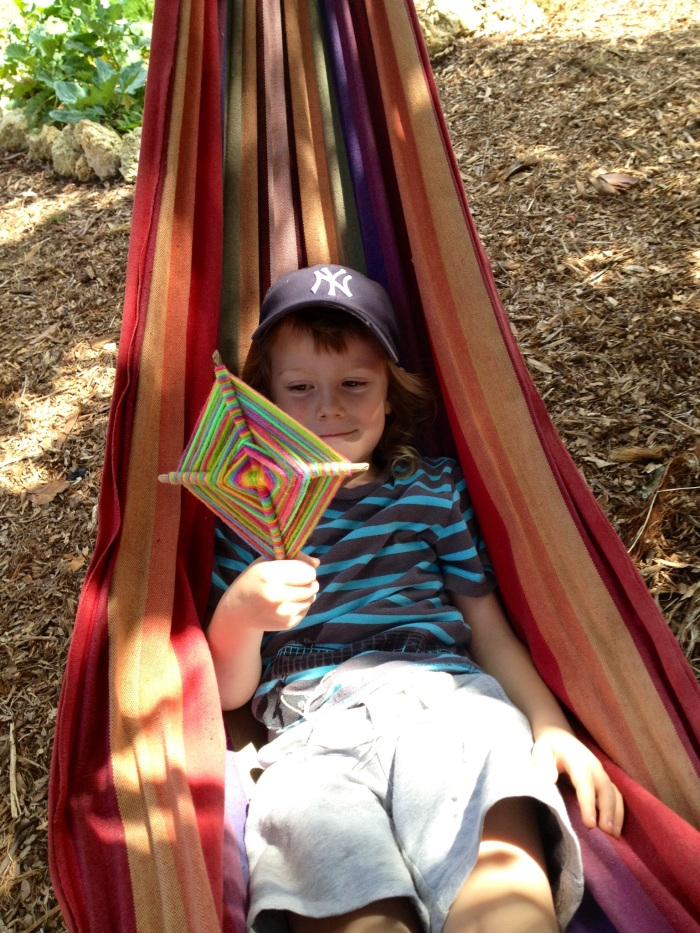 "Happy Ben in the hammock with the awesome ""kite"" Blair helped him make."