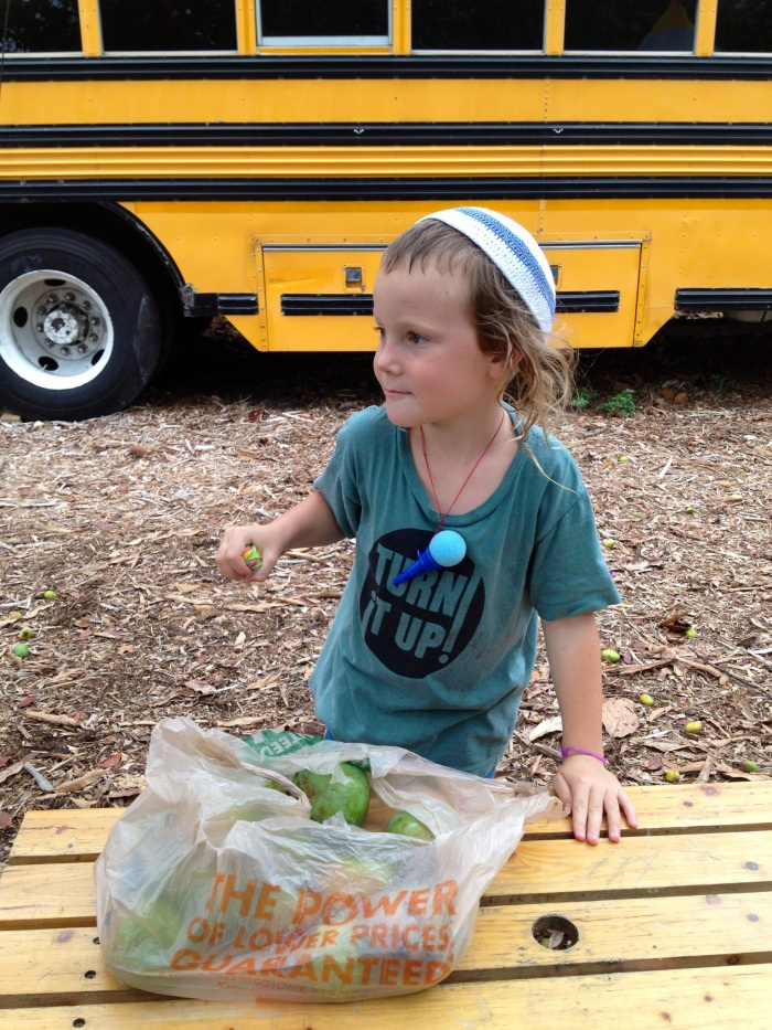 Cutie boy with a bag full of veggies