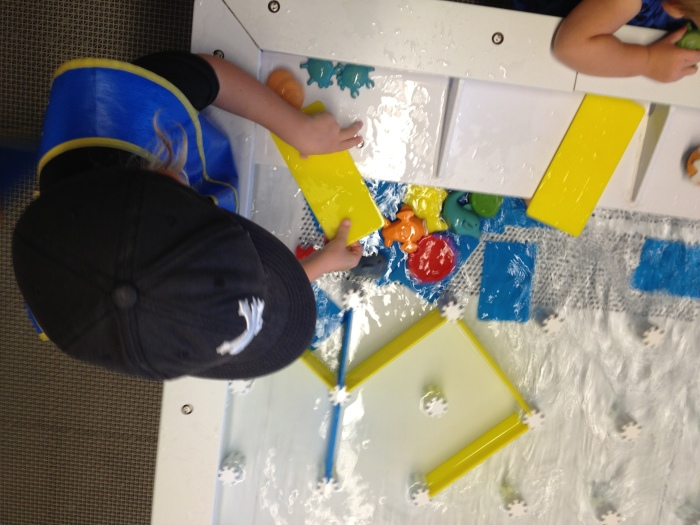 Ben doing some fierce engineering at the water table at an awesome museum we just discovered, Young at Art.