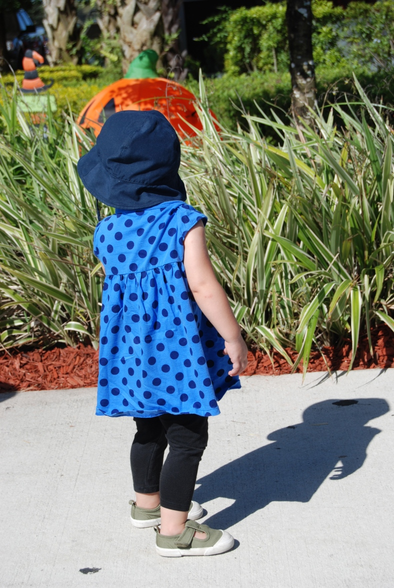 Miss Ella at the pumpkin patch wearing my favorite outfit.