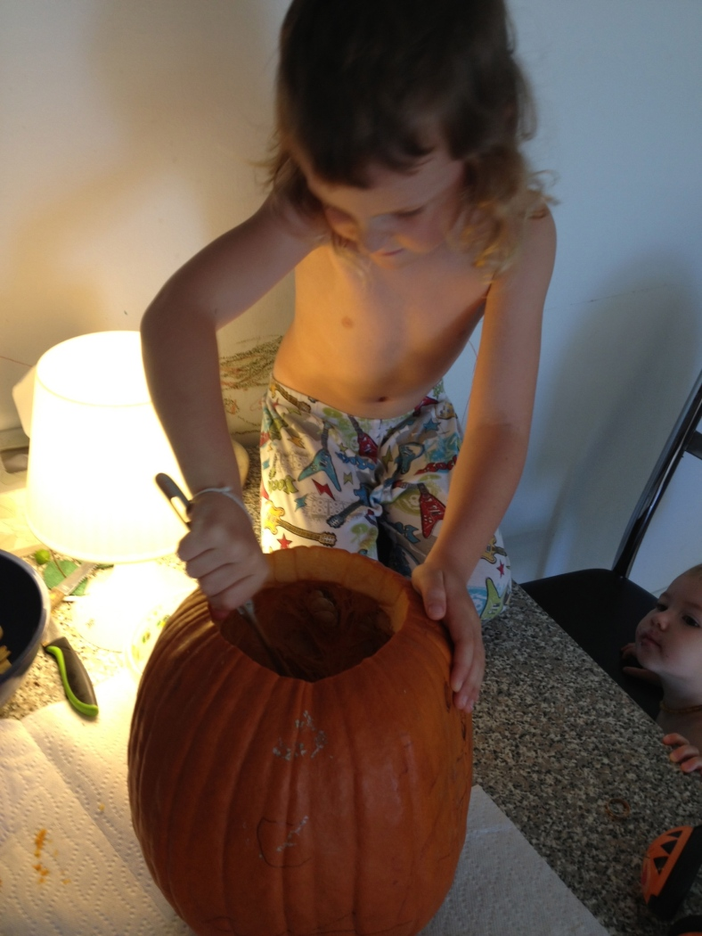 Scooping the goo out of the first pumpkin we've ever carved.