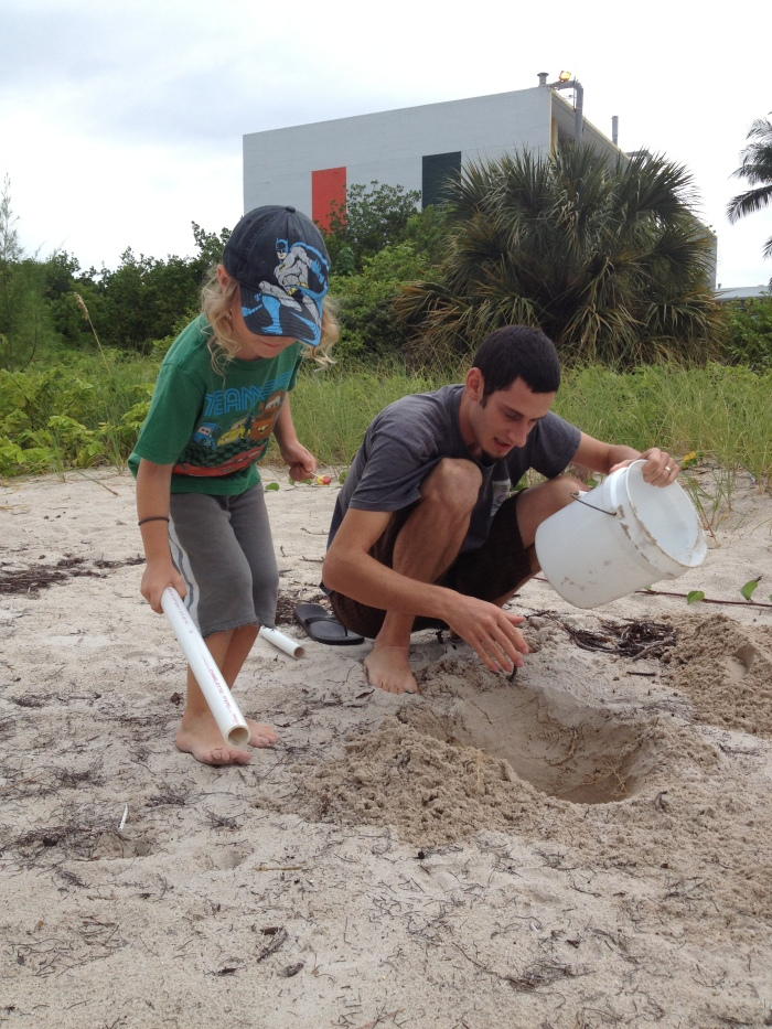 Visiting Uncle Yoni at the lab where he works in Key Biscayne, looking for ghost crabs. We didn't find any, but we did come home with a new pet, a sea snail named Speed.