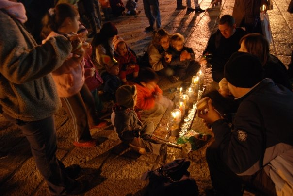 Children lighting candles in the old city, just across from the Kotel.