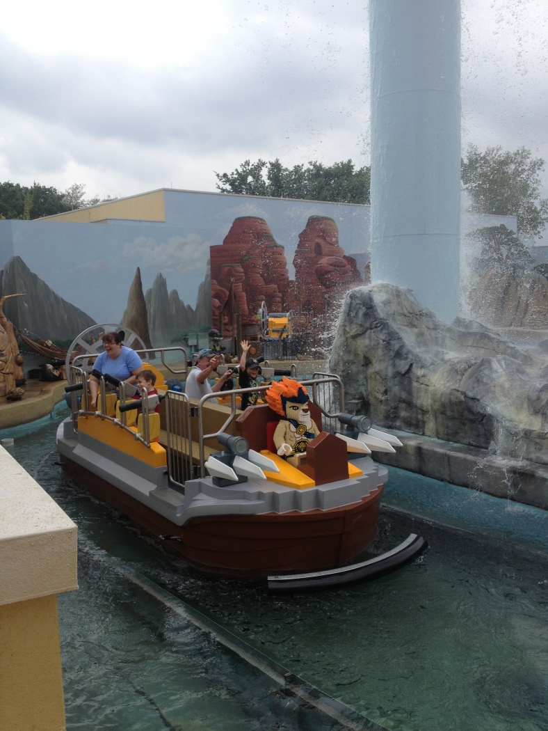 Ben and Grandpa Jim on the water filled Chima ride.